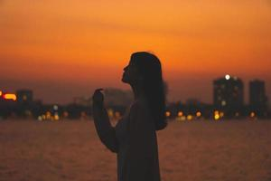 girl silhouette portrait and beautiful sunset photo