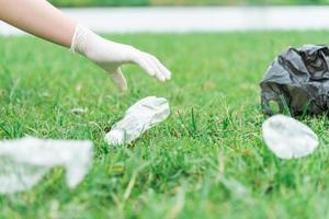 The man volunteered to collect garbage on the lawn photo