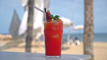 fresh fruits punch with sea beach background video