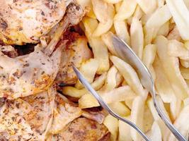 fried chicken thighs and fries photo