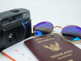 Travel concept with accessories and passport isolated on white background photo