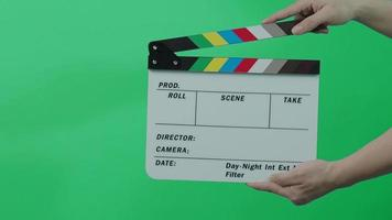 Movie film slate. close up hand clapping empty film slate video