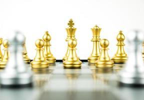 Gold and Silver King and Knight of chess setup on white background . Leader and teamwork concept for success. Chess concept save the king and save the strategy photo
