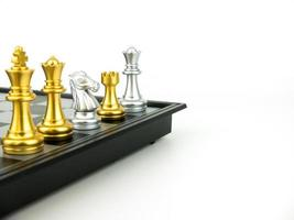 Gold and Silver King and Knight of chess piece setup on white background . Leader and teamwork concept for success photo