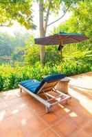 umbrella and pool bed around swimming pool photo