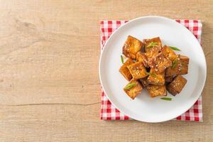 fried tofu with white sesame and teriyaki sauce photo