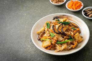 stir-fried noodles with tofu and vegetables photo