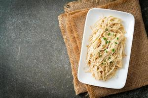 stir-fried golden needle mushroom with butter photo