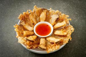 deep fried Enoki mushroom and King Oyster mushroom with spicy dipping sauce photo