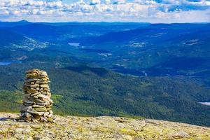 Amazing Norway norwegian landscape Stacked stones summit top of mountain. photo