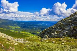 Amazing Norway norwegian landscape boulders at summit top of mountain. photo