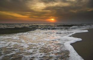 Lanscape of sunset sky beach and sea wave  with outdoor low lighting. photo