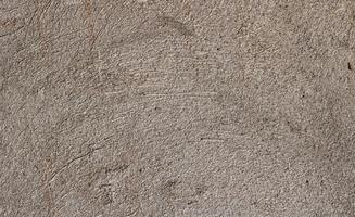 Old scratched outer wall decoration, warm gray color. texture photo