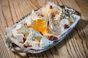different type of cheese on the tray and cocktail photo
