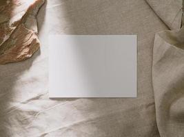 Invitation card mockup, blank greeting card template. Flat lay, Minimalist style photo