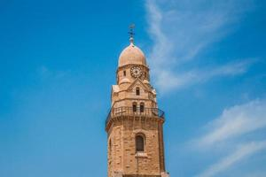 The clock tower of the Abbey of the Dormition building at mount zion in Jerusalem photo