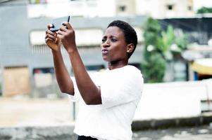 young woman taking a picture. photo