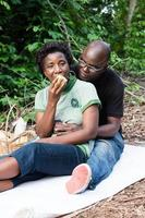 love couple sitting on a mat in the bush. photo