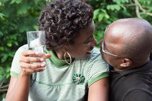 Couple kissing outdoors photo