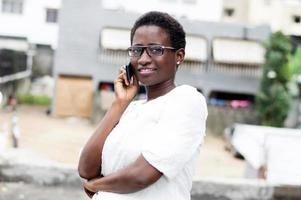 young woman on the phone with a smile. photo
