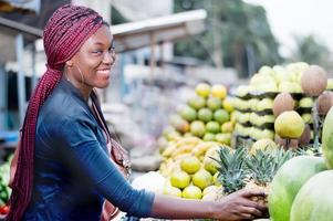 young woman smiling at fruit market photo