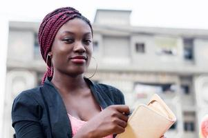 smiling young woman with a purse. photo