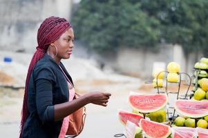 young woman at street  fruit market. photo