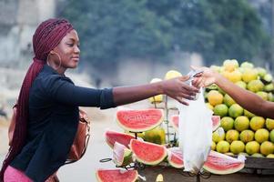 young woman buying fruit. photo