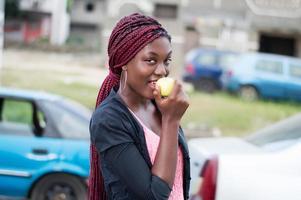 young woman enjoying an apple. photo