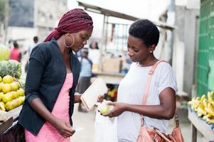 two young women at fruit market. photo