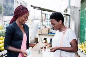 happy young women at the market photo
