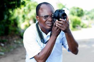 young man taking pictures with a digital camera in campaign photo
