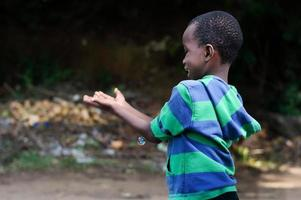 little boy playing with bubbles. photo