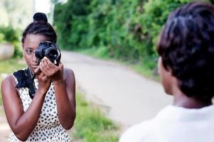 young woman taking a photo with her girlfriend.