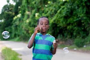 child blowing bubbles. photo