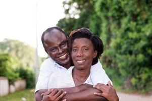 happy young couple embracing in countryside. photo