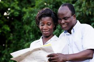 happy young couple traveling consult a map. photo