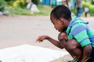 child seeking his mark on a map. photo