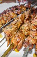 Russian shashlik with skewers on a white plate background. photo