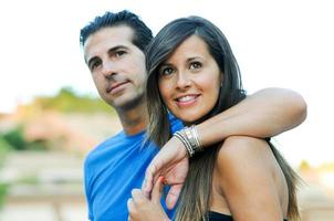 Happy young couple looking at something interesting - Copyspace photo