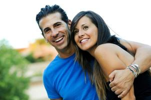 Portrait of a beautiful young couple smiling together photo