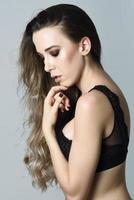 Woman with long hair wearing black lingerie photo