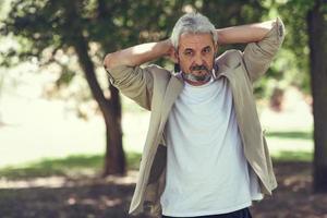 Mature man, model of fashion, in an urban park. photo