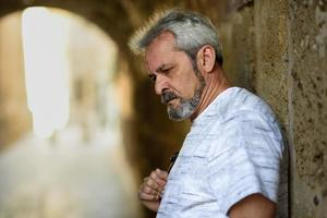 Portrait of a mature serious man in urban background. photo
