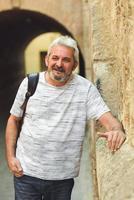 Mature man smiling in urban background photo