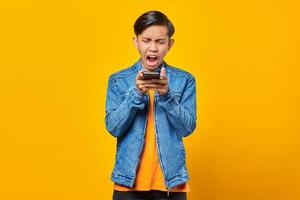 portrait of asian man angry when talk at smartphone photo