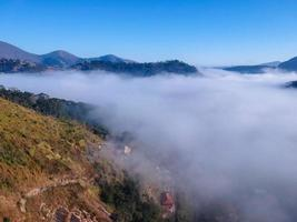 Aerial view of itaipava petrpolis early morning with a lot of fog in the city photo