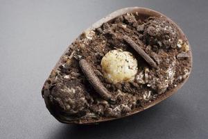 brazilian easter dessert chocolate egg with cream photo