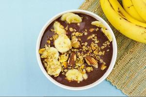brazilian nuts on white bowl with banana photo