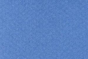 Fondo de papel con textura azul. fotograma completo foto